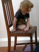 2y 11m turns to sit on chair_1.jpg
